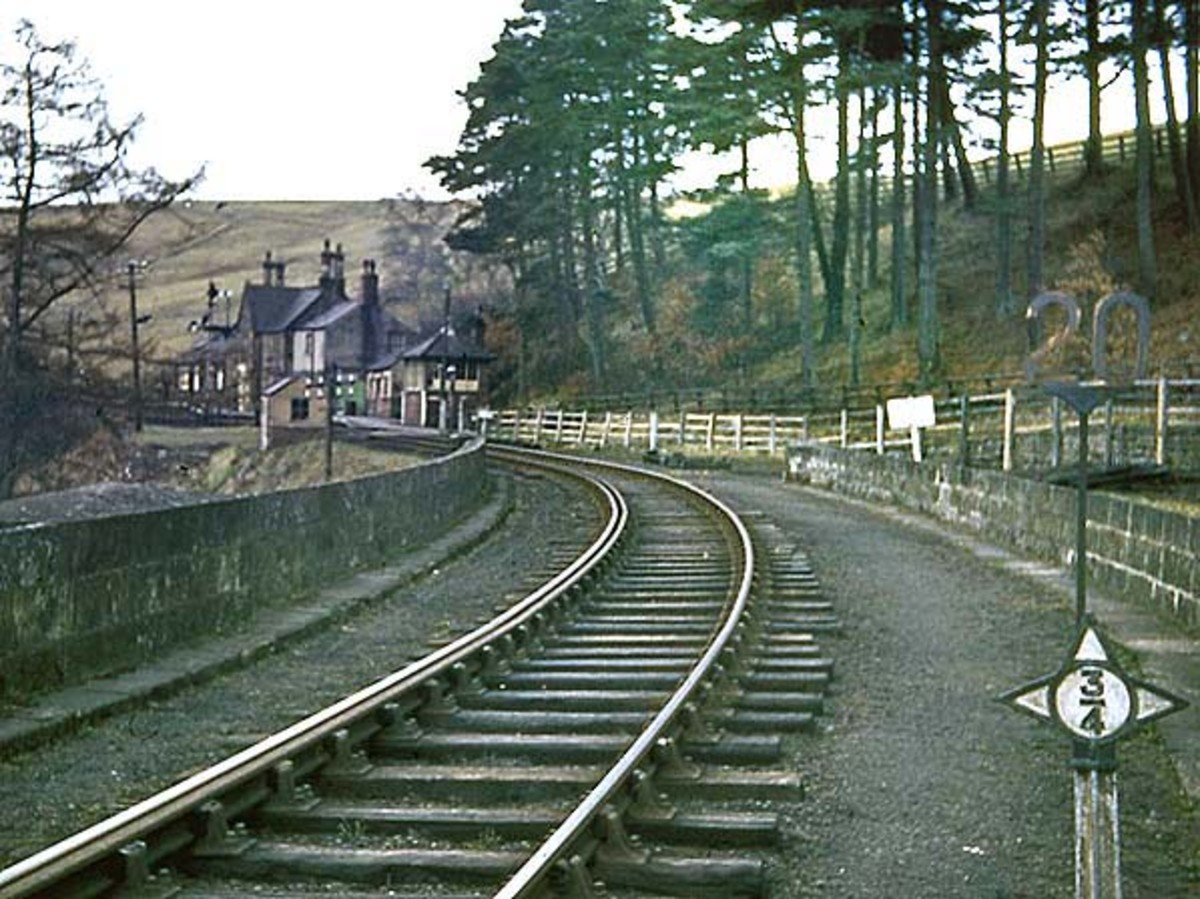 A Brian Johnson photograph of Lambley Station at the south-eastern end of the viaduct. The post (right) is an NER 3/4 mile measurement from the last half-mile post, a quarter mile post before that and so on. Measurements made from a branch datum post