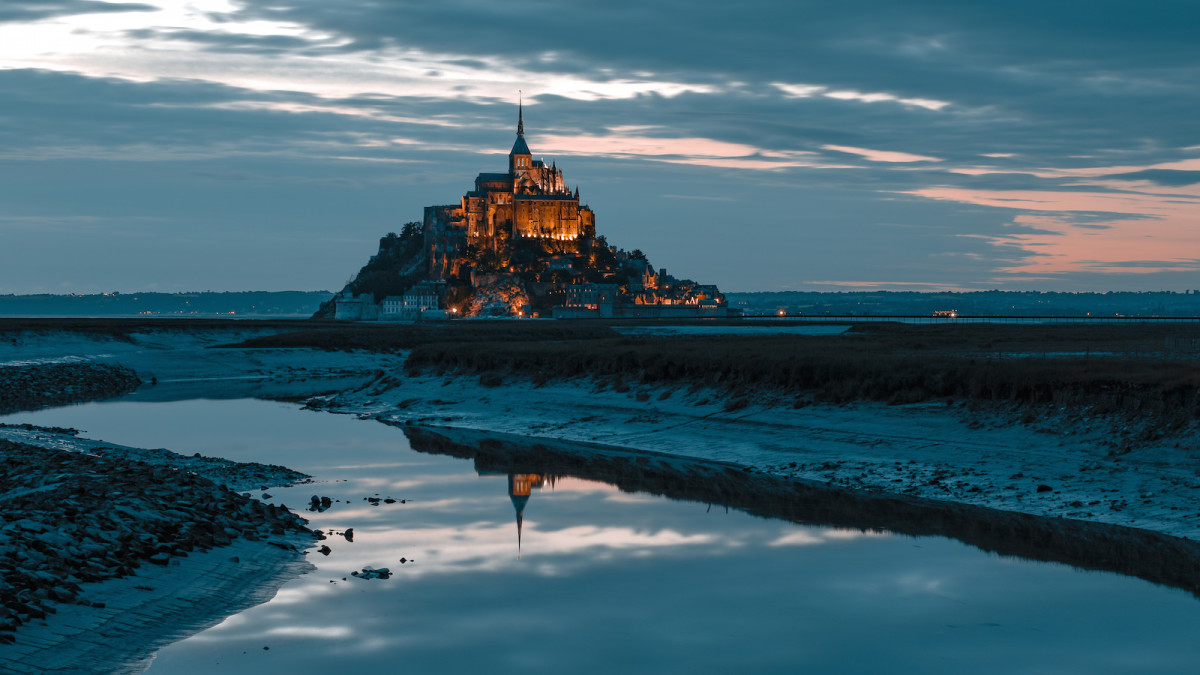 On the coast of Brittany, Mont St Michel west of the mouth of the River Selune