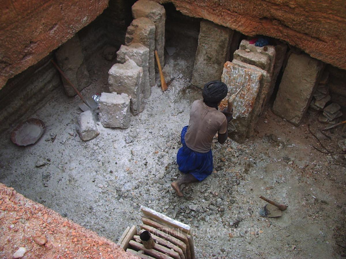 A salt miner working in the Taodenni salt mine.