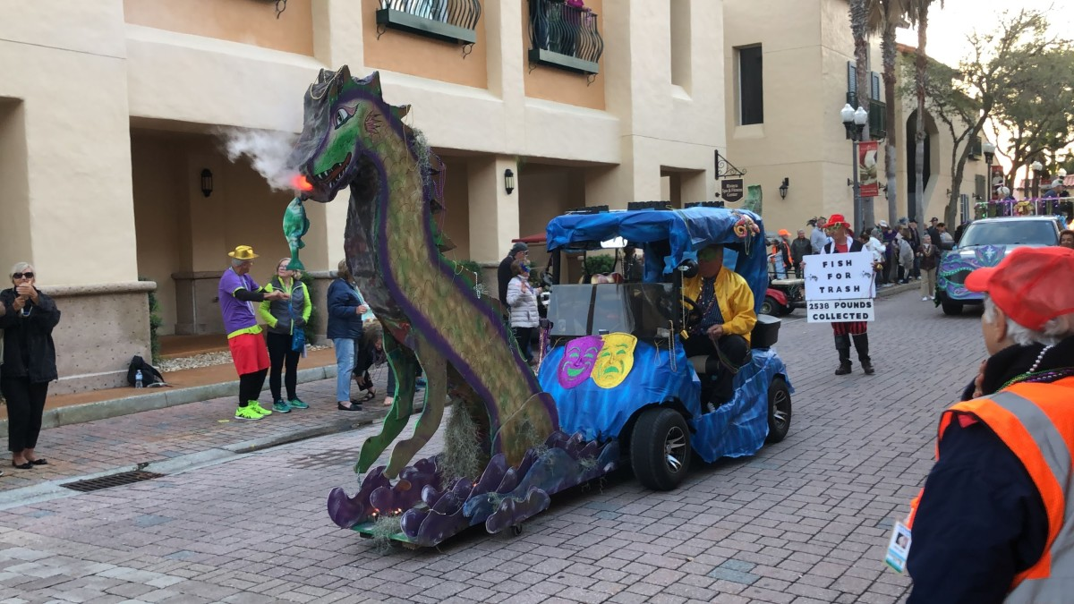 By attaching a platform to the front of the golf cart, they provided room for this fire-breathing dragon. Very creative.