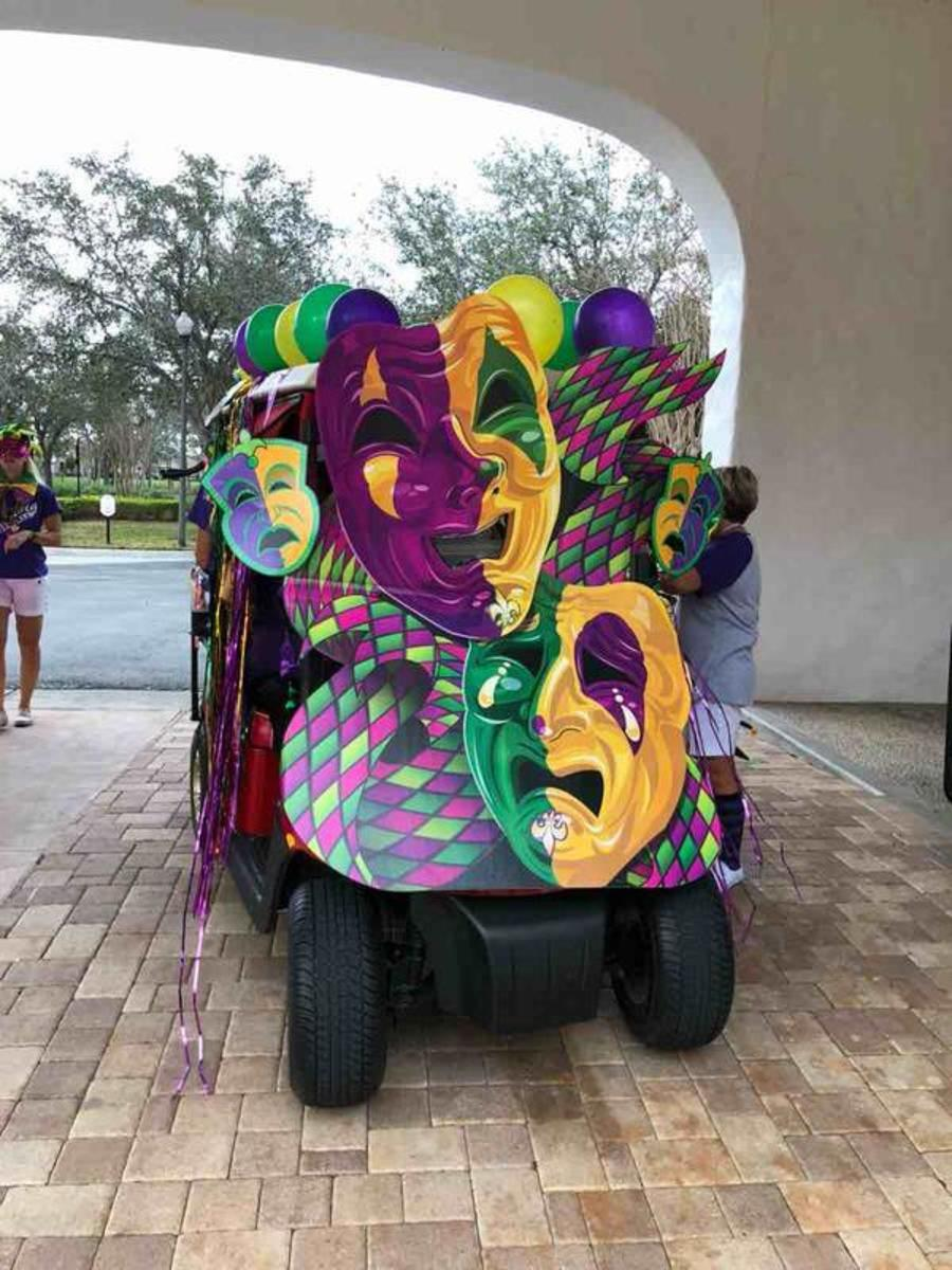 Clever placement of the giant masks leaves several openings so the driver can see to drive the golf cart.
