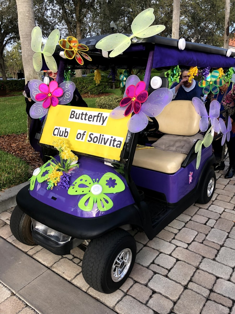 Very large, colorful butterflies fancy up this cart.  Different clubs decorate a cart for the parade to call attention to their activities. This is the first year for the Butterfly Club which teaches its members to raise and release butterflies.