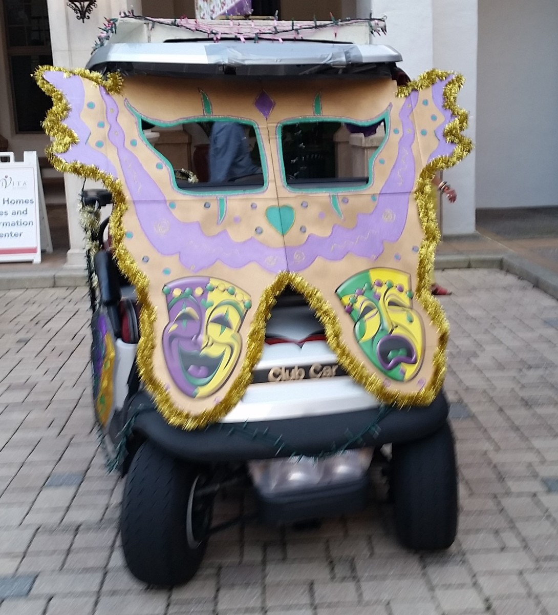 Giant butterfly design in Mardi Gras colors with cut-out windows for the driver to see out.