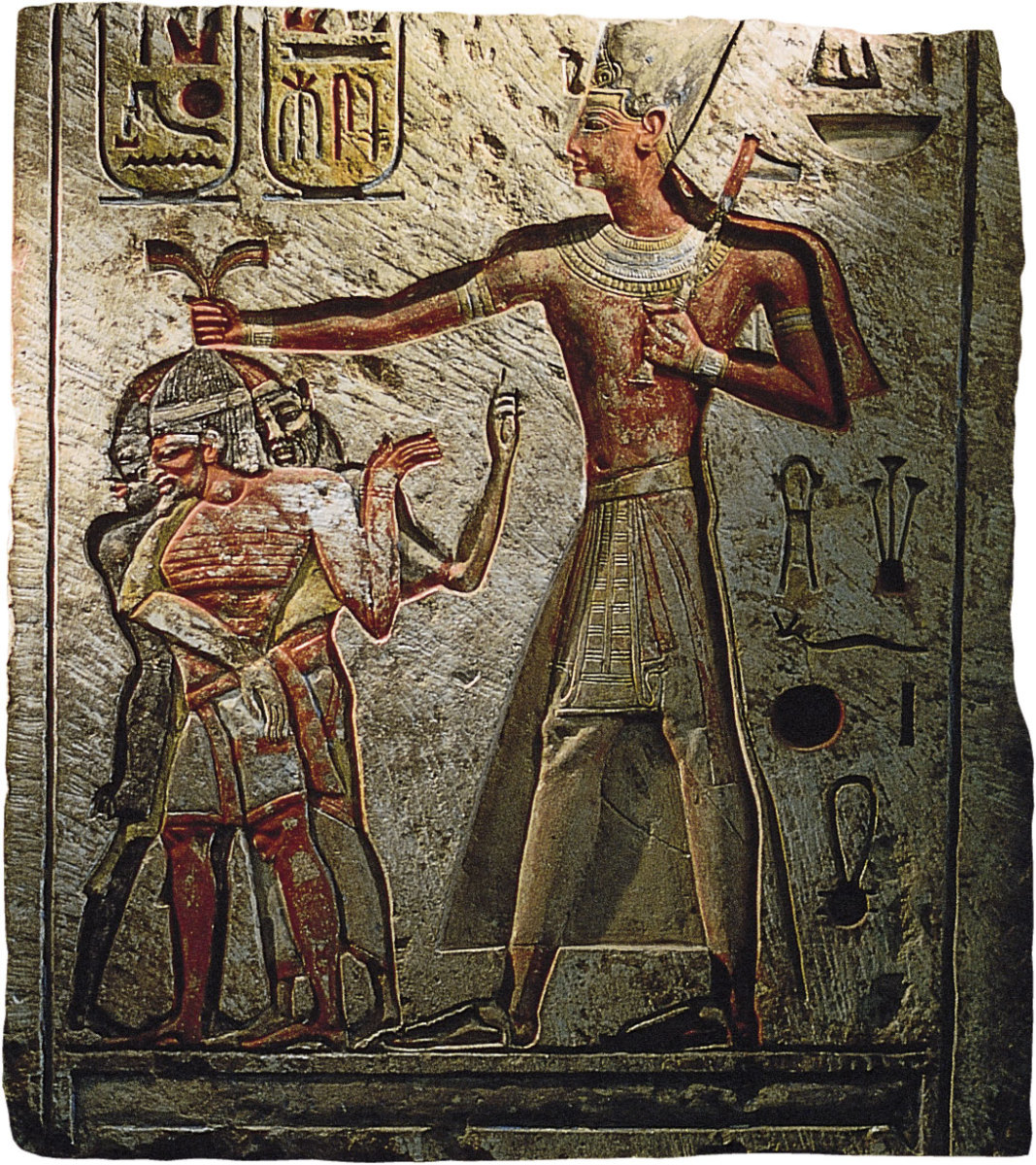 Ramesses II Pulling the Hair of Bearded Slave on a Bas-Relief from Memphis