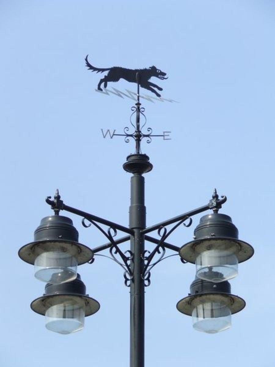 Street light and weather vane depicting Black Shuck