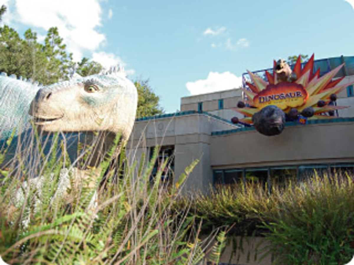 Aladar, the Iguanadon from Dinosaur the movie, in front of the entrance to DINOSAUR the ride.
