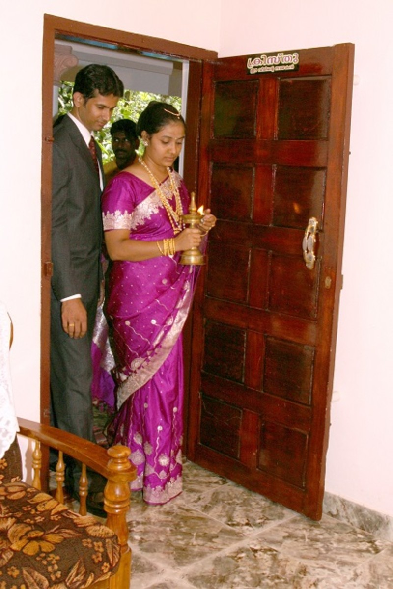 Bride enter's groom's house with Lighted lamp.