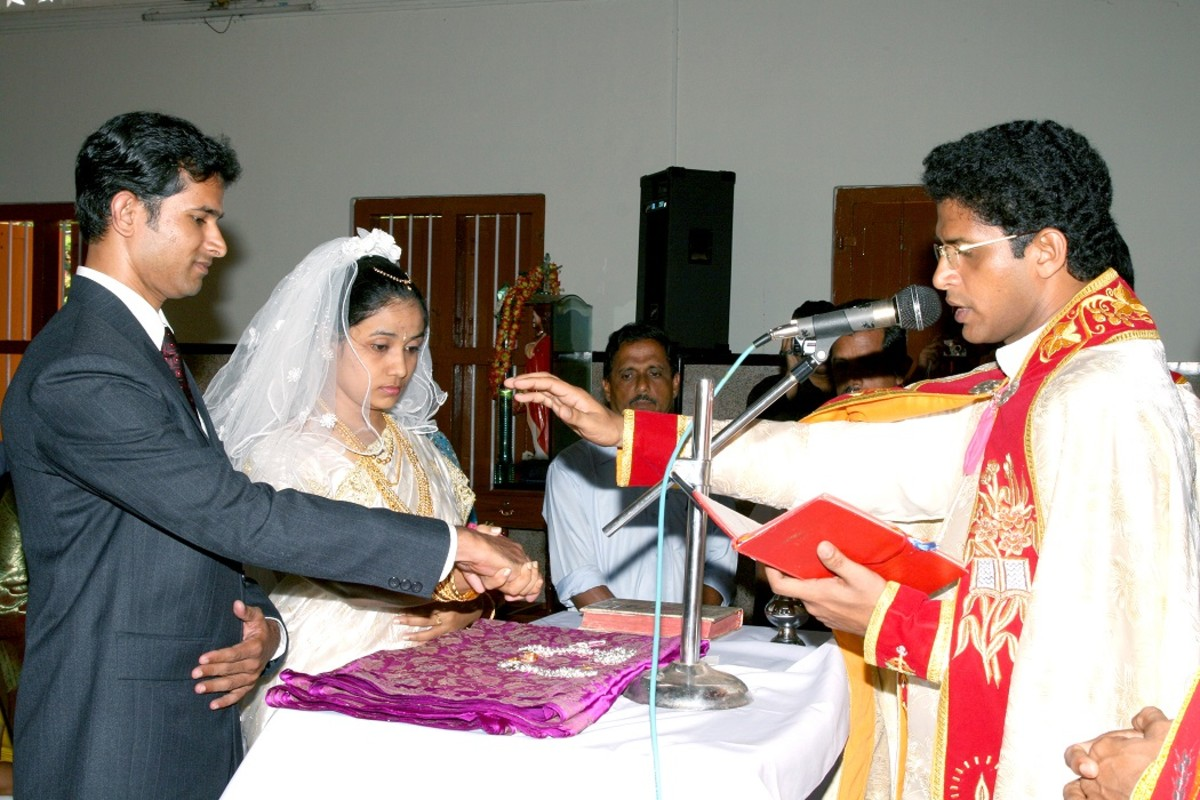 Priest blessing the marriage