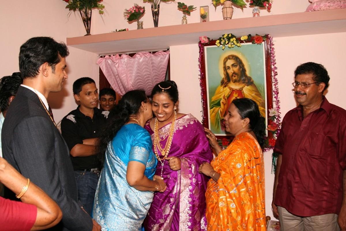 Handing over bride to groom's mother.