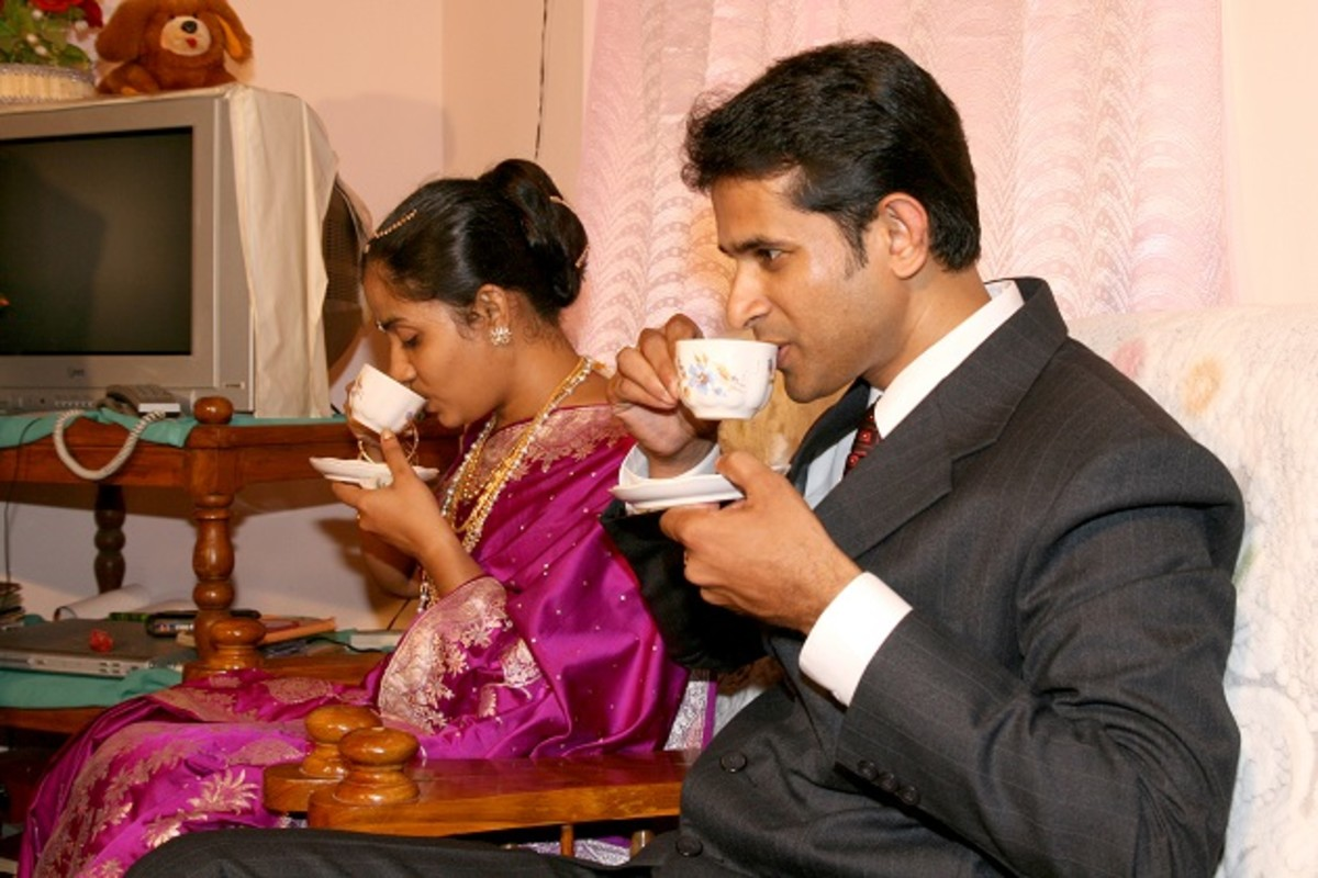 Giving sweetened milk to the couple at groom's house