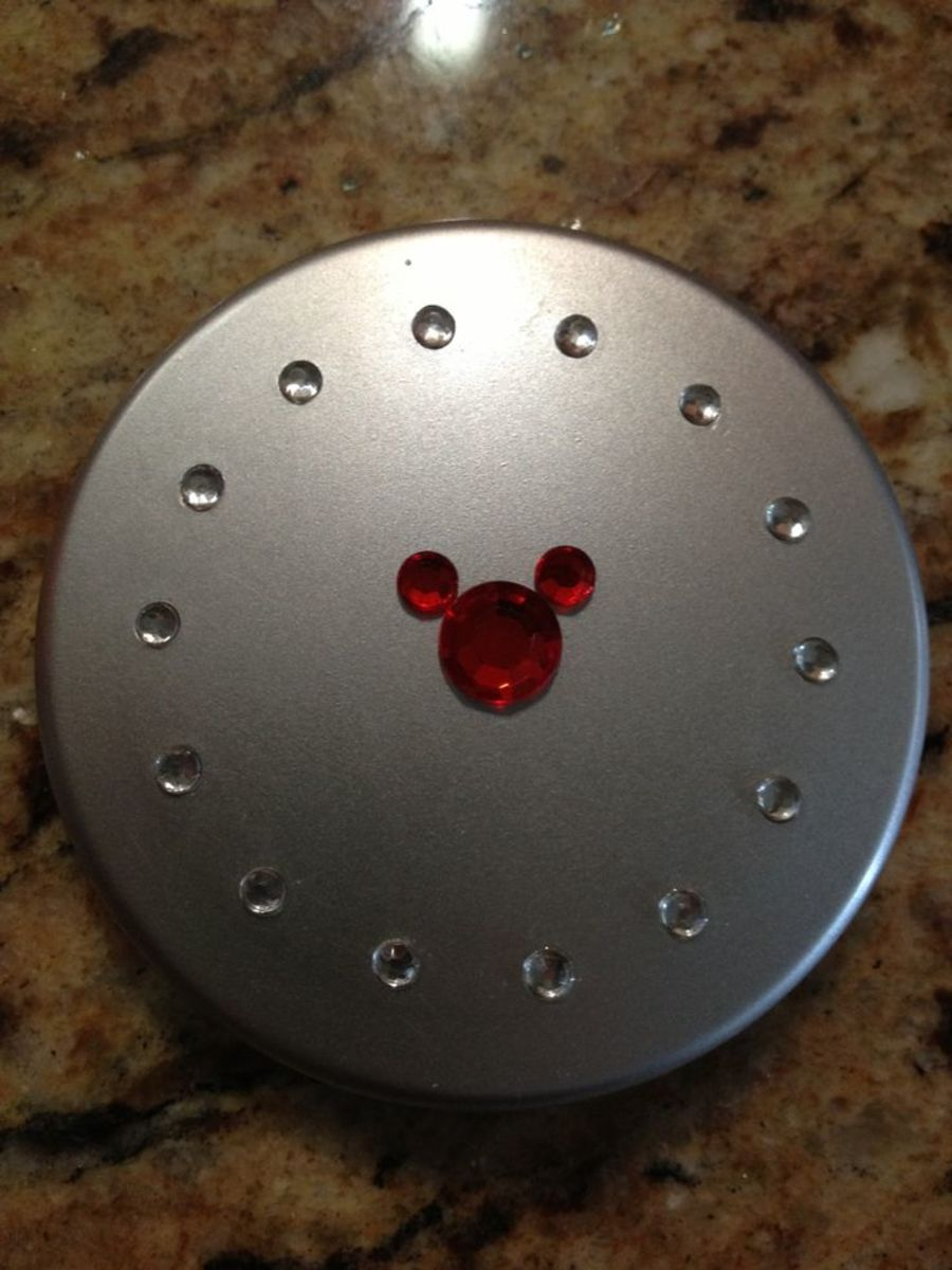 Makeup compact with gem sticker.