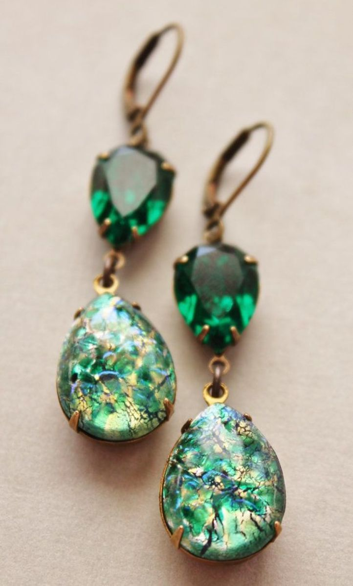 Earrings made with vintage, rare, green fire opals.