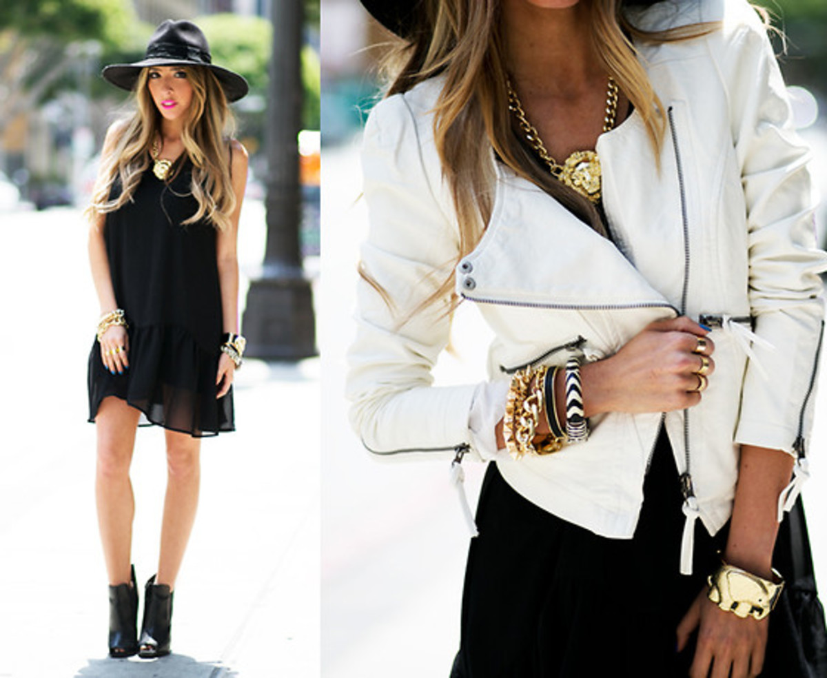 Wear a short black dress and a white leather jacket.  Add a black hat to complete the look.