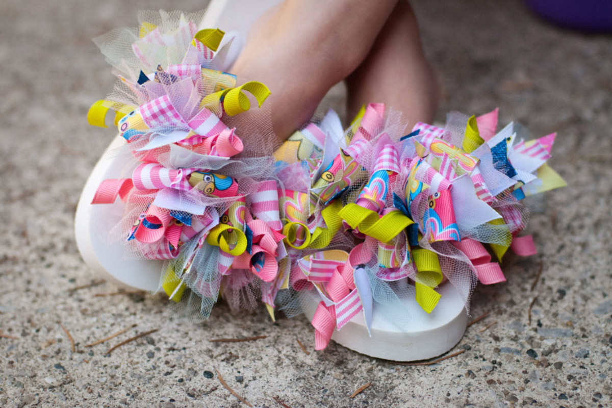 Tie pieces of ribbon onto a pair of flip flops. This project is great for all those pieces of scrap ribbon.