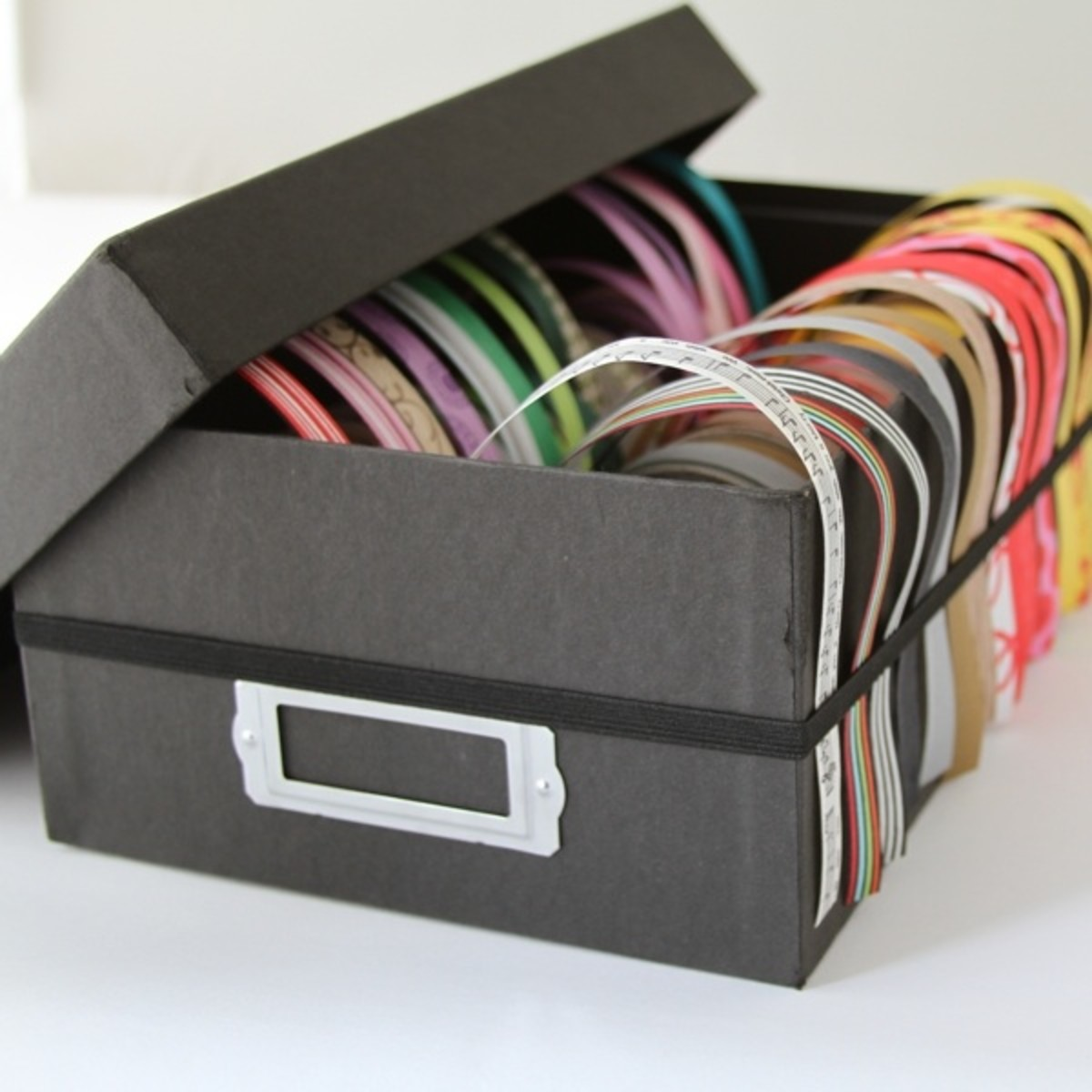 A simple ribbon photo box storage idea
