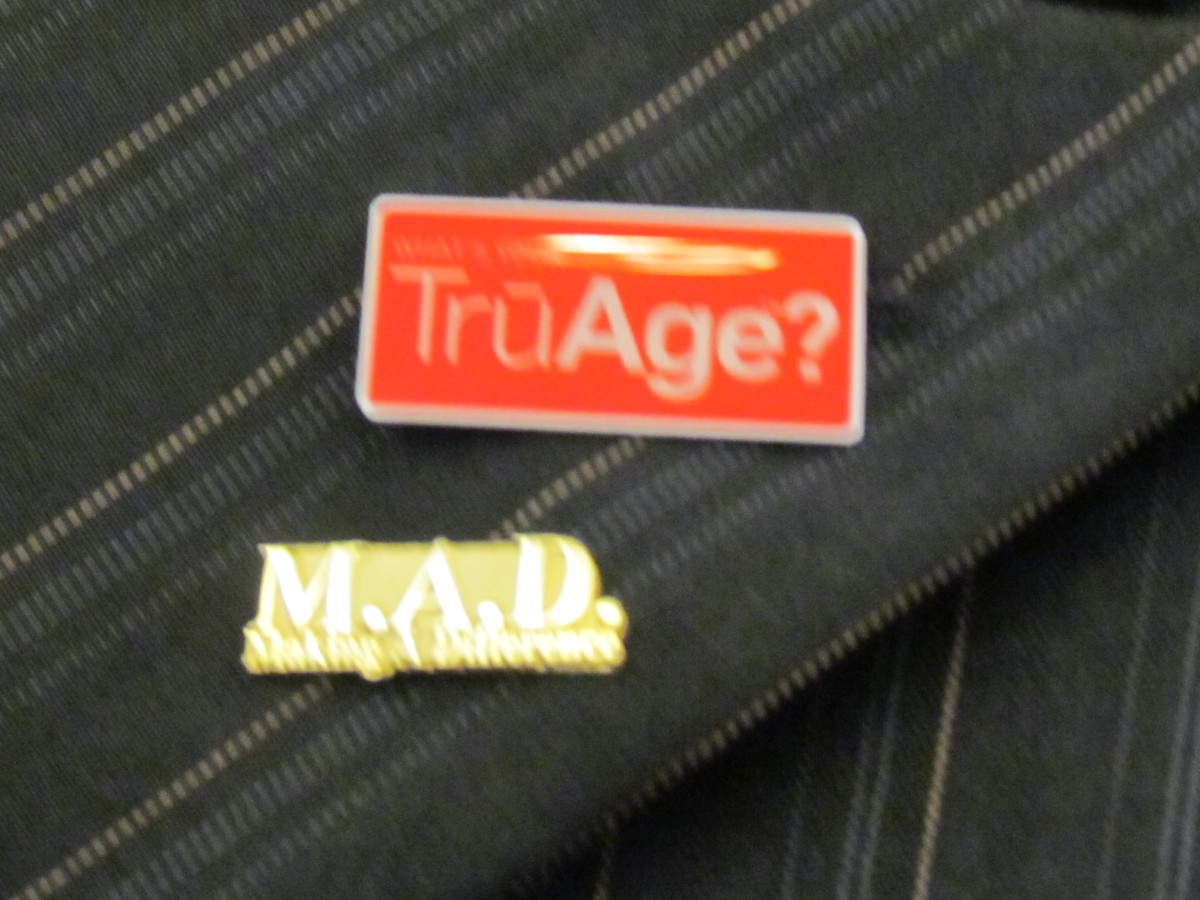 Pins that were worn by members for the TruAge products that are available on Morinda's website.