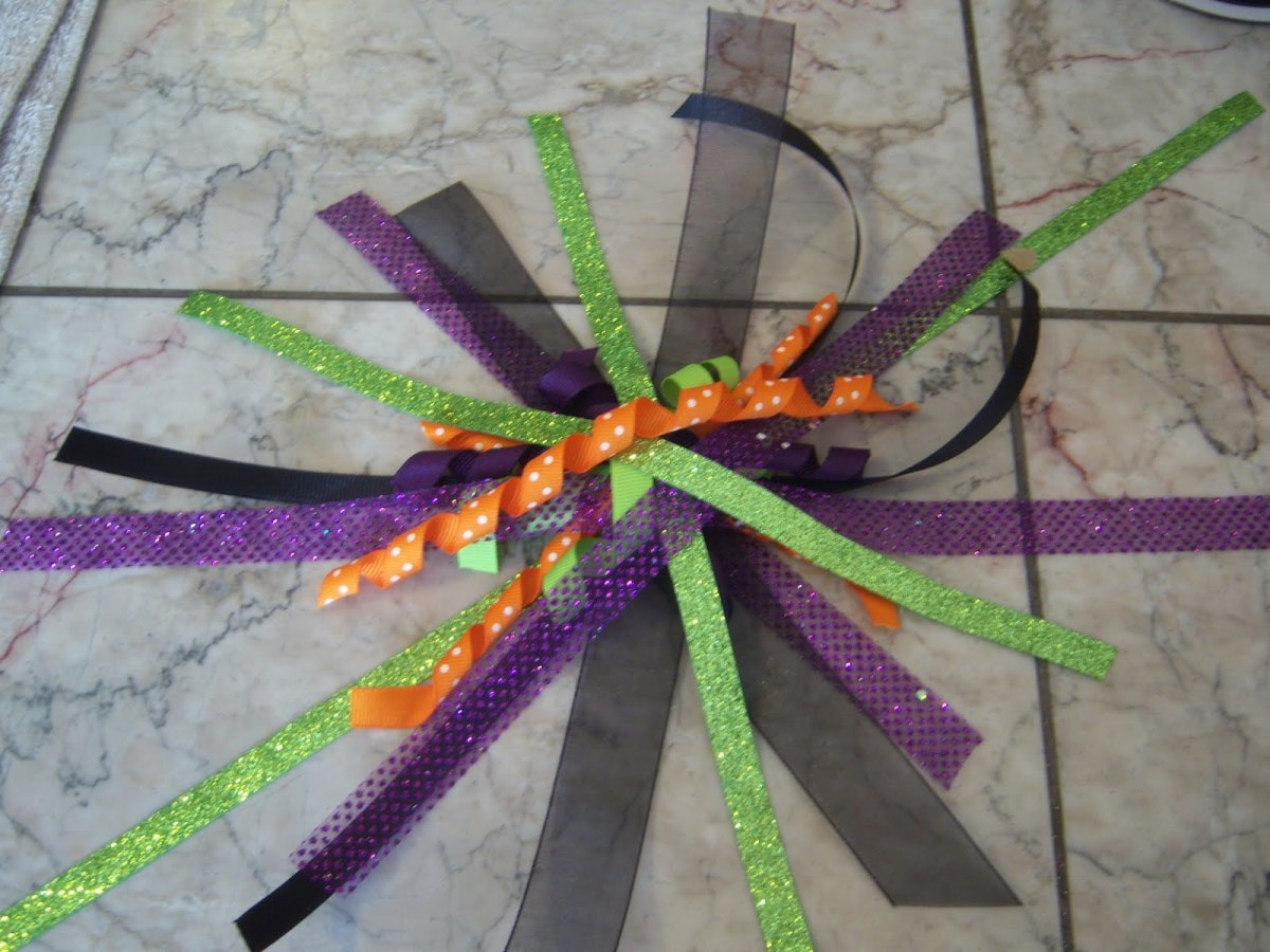 Lay all your ribbons across the flat ribbon and tie them together - knot it tight and knot it again!