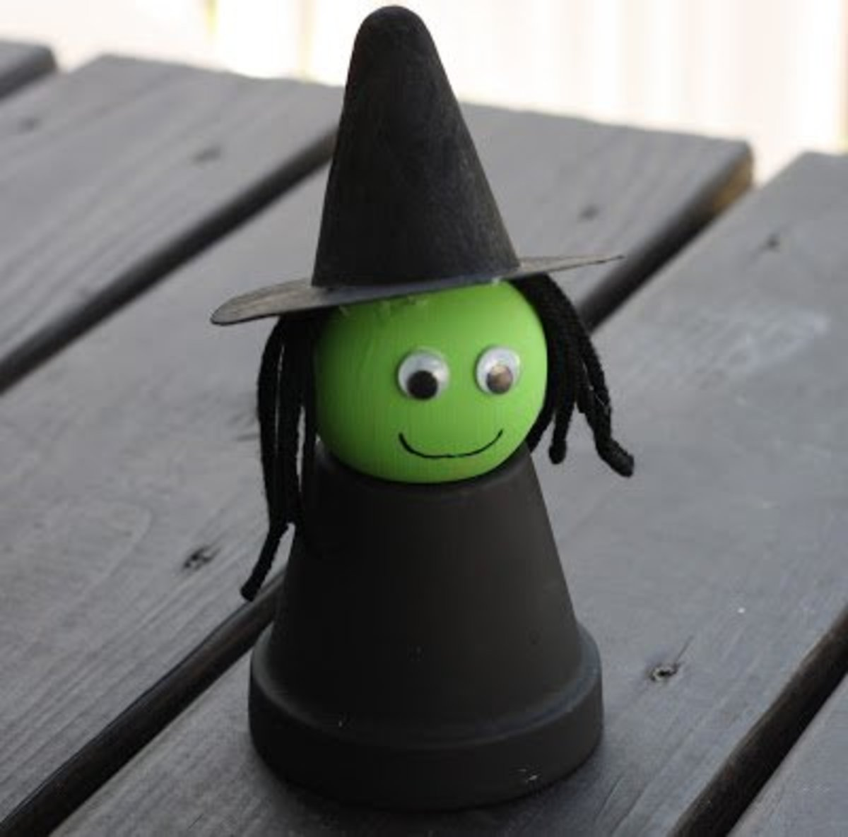These little witches, made from flower pots, will look great on your porch or inside your home as a Halloween decoration.