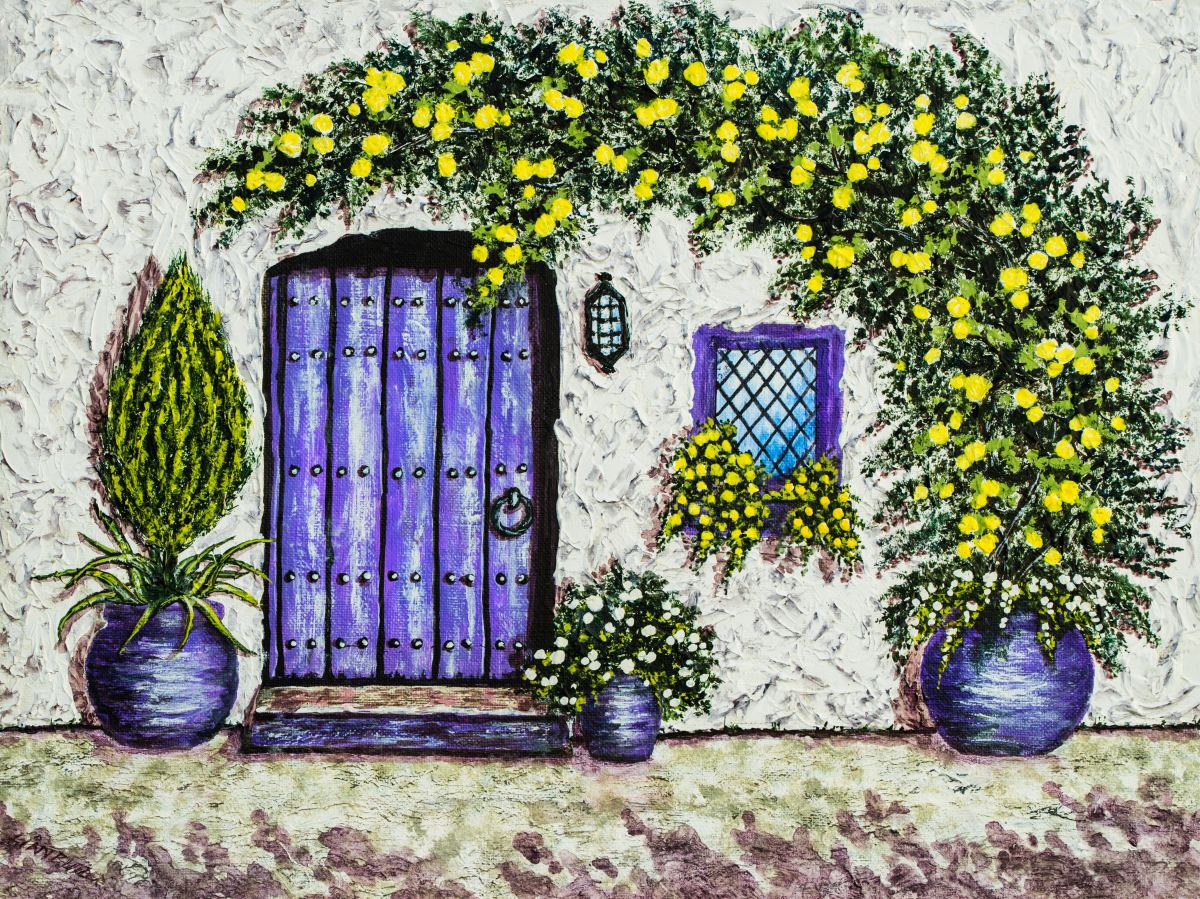 A yellow flower vine arches over cottage doorway from an outdoor planter