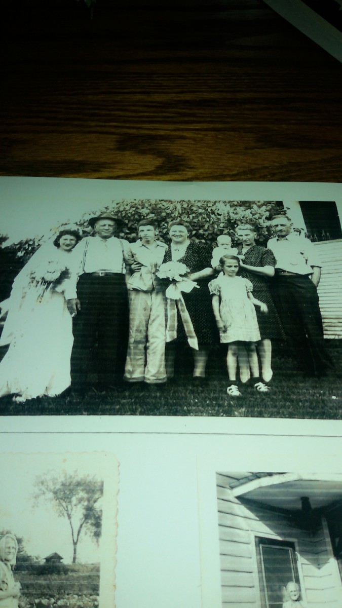 From left to right:  aunt Sissy, great uncle Henry Schmidt, uncle Leo, unknown female, grandma Schmidt holding aunt Mary, grandpa William Schmidt.  Aunt Donna is standing in front of grandma.  Taken probably in 1945.