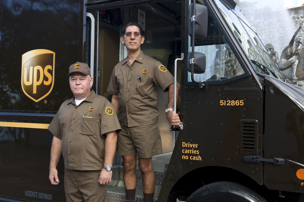 Does United Parcel Service really need two people to do a one-man or one-woman job?  And, do they ever take off those shorts and get some long pants, even in the middle of winter?