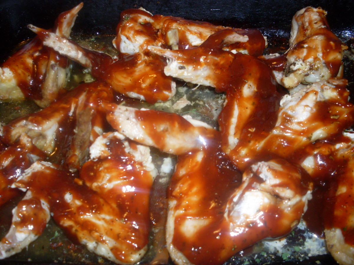 use a brush to brush the barbecue sauce on to the chicken wings