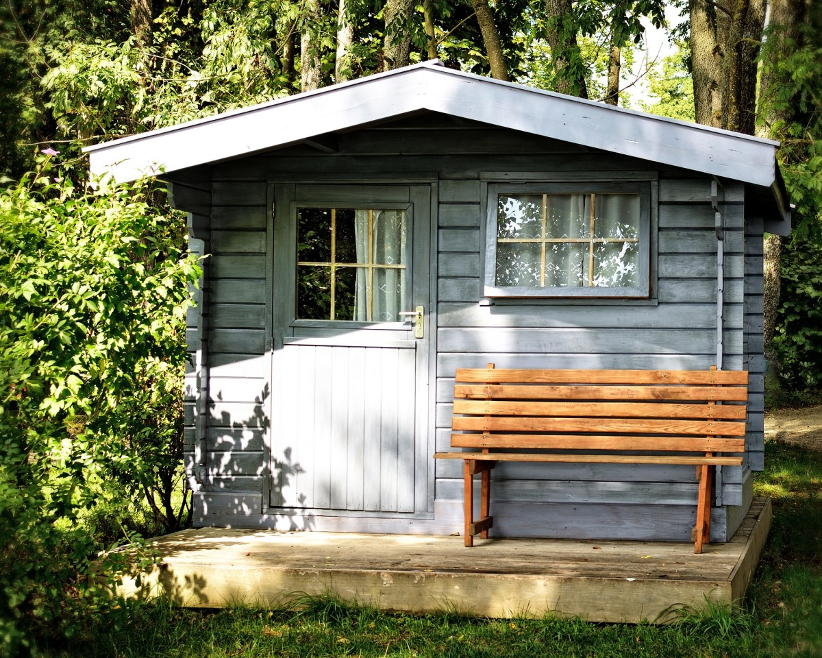 This is an attractive and homey style of shed which compliments the main house.