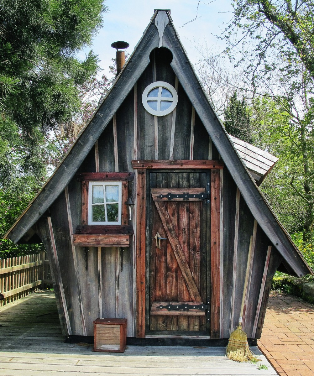 A witch's house for a children's playhouse. Building this wooden shed would be a fun and challenging project for a wood craftsman.