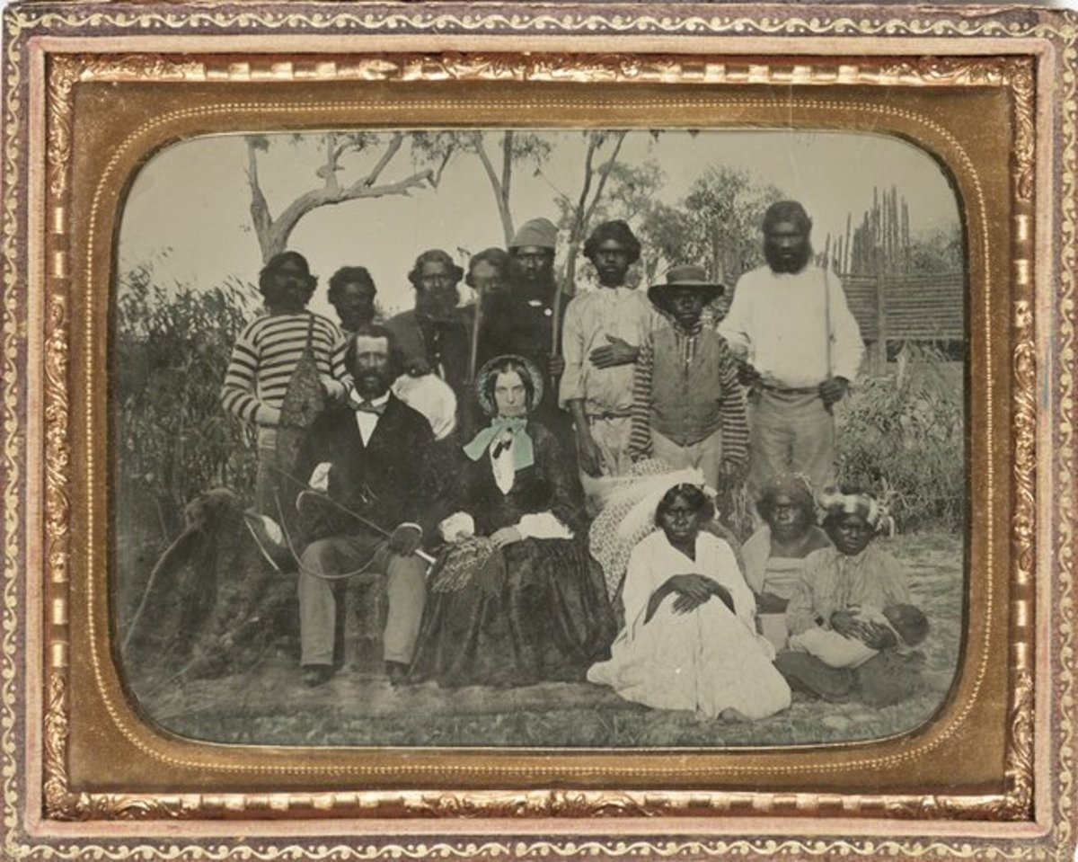 Slave owner with his family and slaves.  Date and place unknown.