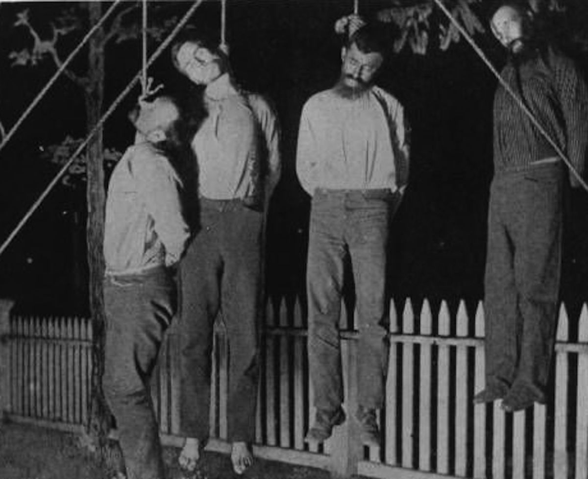 Lynching of four white men.  Although less common, white men were also lynched before they could be granted a fair trial; common allegations were claim jumping or stealing horses.