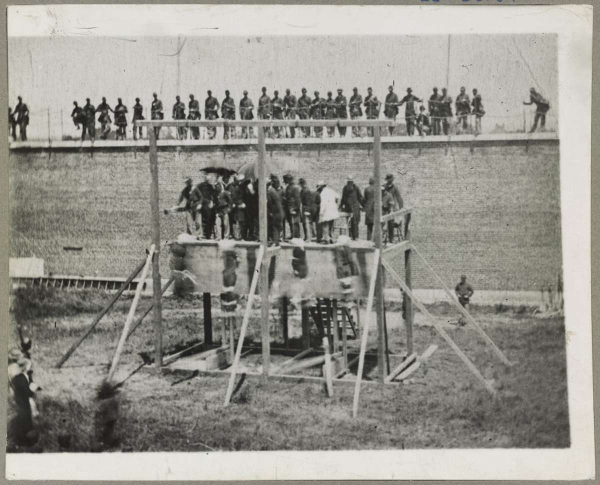 Hanging of four conspirators in President Lincoln's assissination, including one woman.