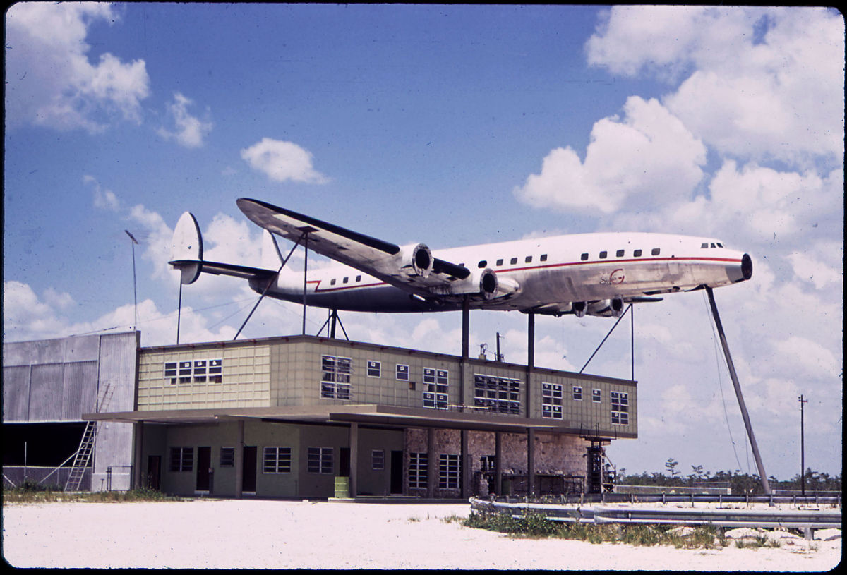 A Constellation on display over an abandoned building, Florida, 1970.