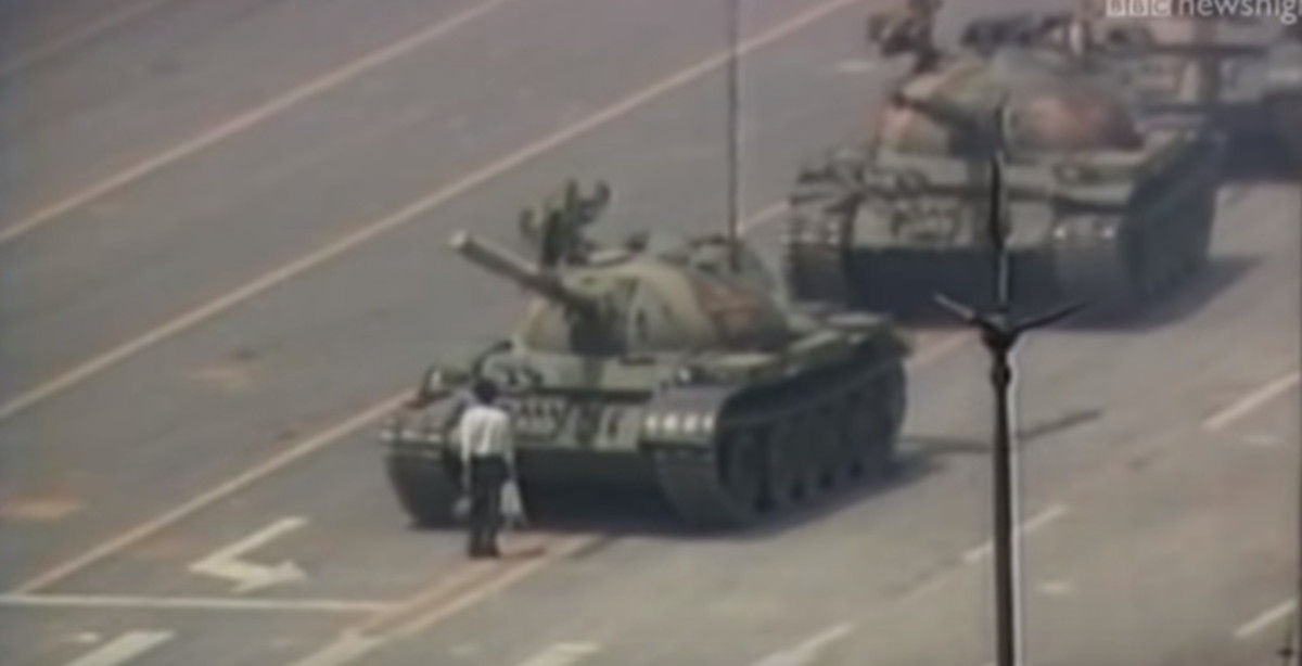 "The unidentified Chinese man. Known only as the ""Tank Man"" who risked his life standing in front of a convoy of incoming tanks at the Tienanmen Square protests."
