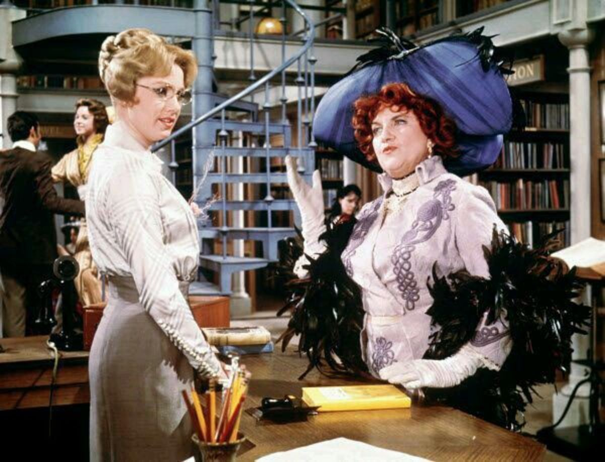 Mrs. Shinn confronting Marian, the librarian over the quality of the books she has in the library. Shirley Jones and Hermoine Gingold