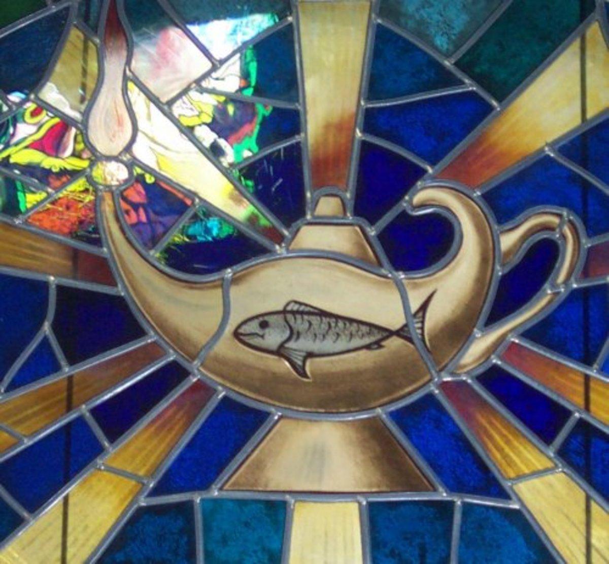 Fish, lamp and sun symbol in a church in Vilaflor