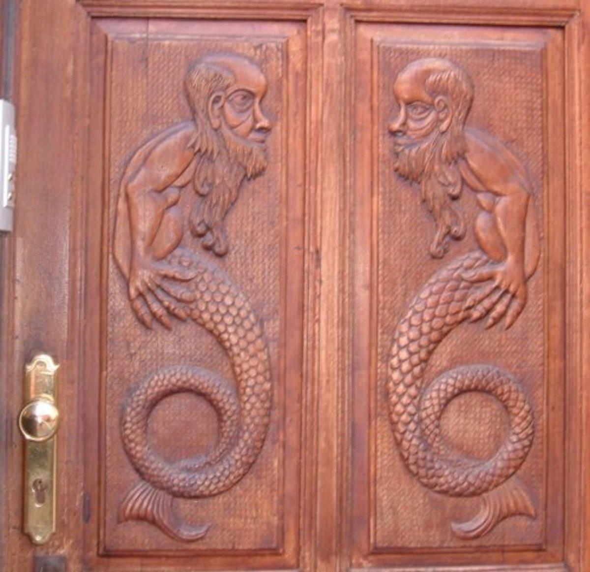 Mermen on a door in Icod town centre
