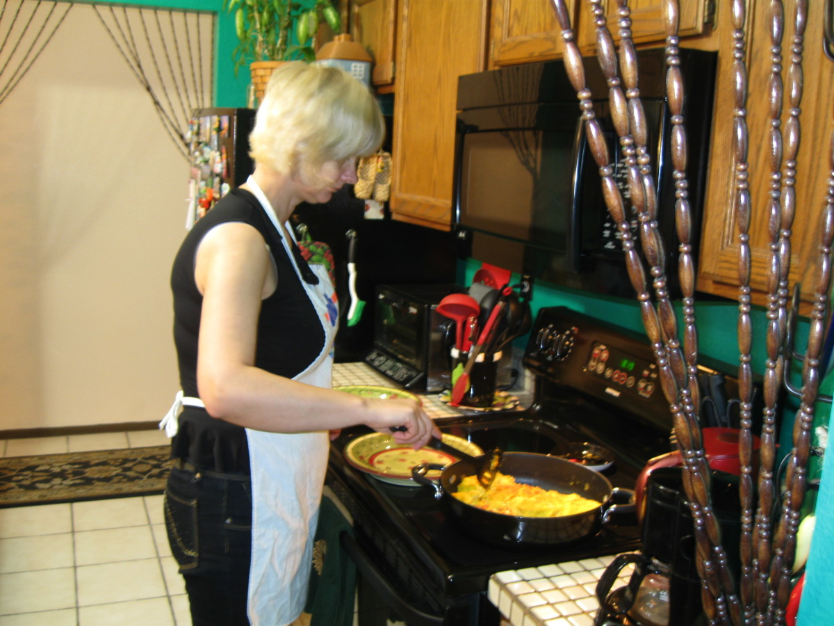 My wife preparing to serve the ostrich egg omelet.