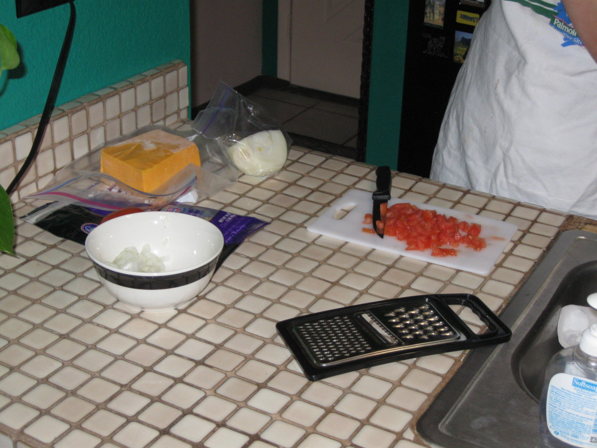 Ingredients and tools needed to make an Ostrich egg omelet