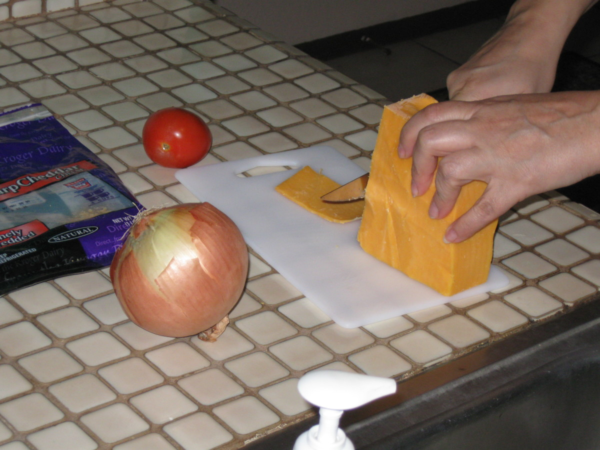 Slicing some cheese for the for the ostrich egg omelet