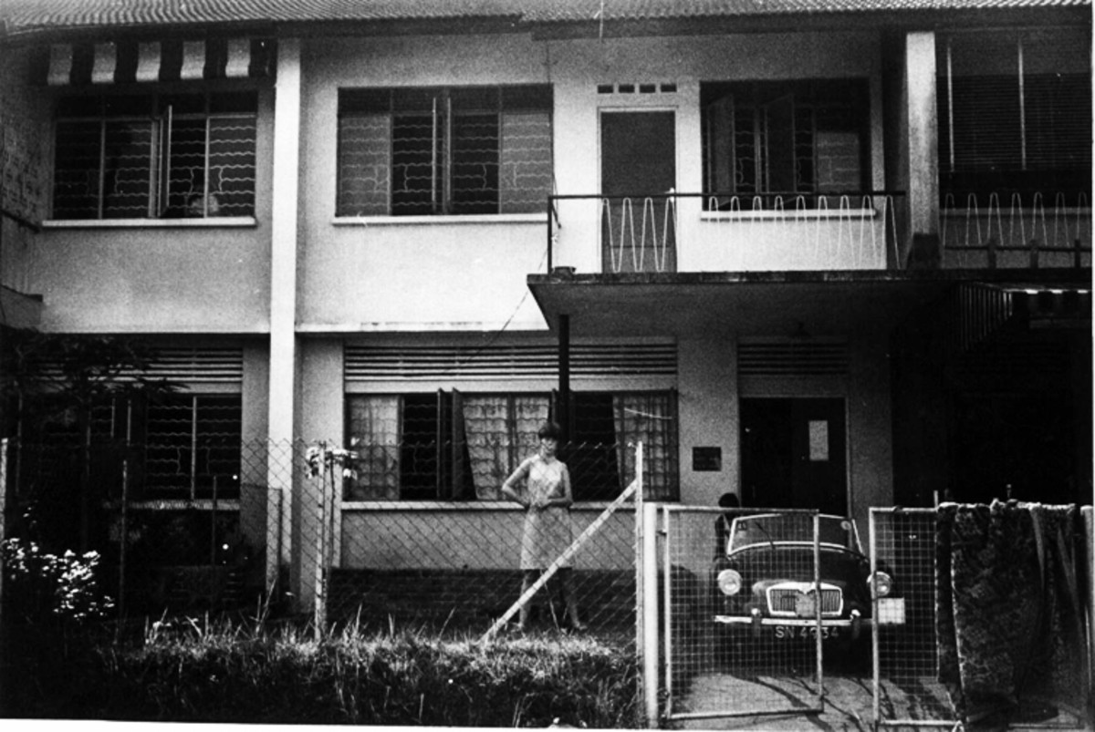 I am standing outside our first house which is on Jalan Labu Ayer roughly translated I think means Water Melon Road