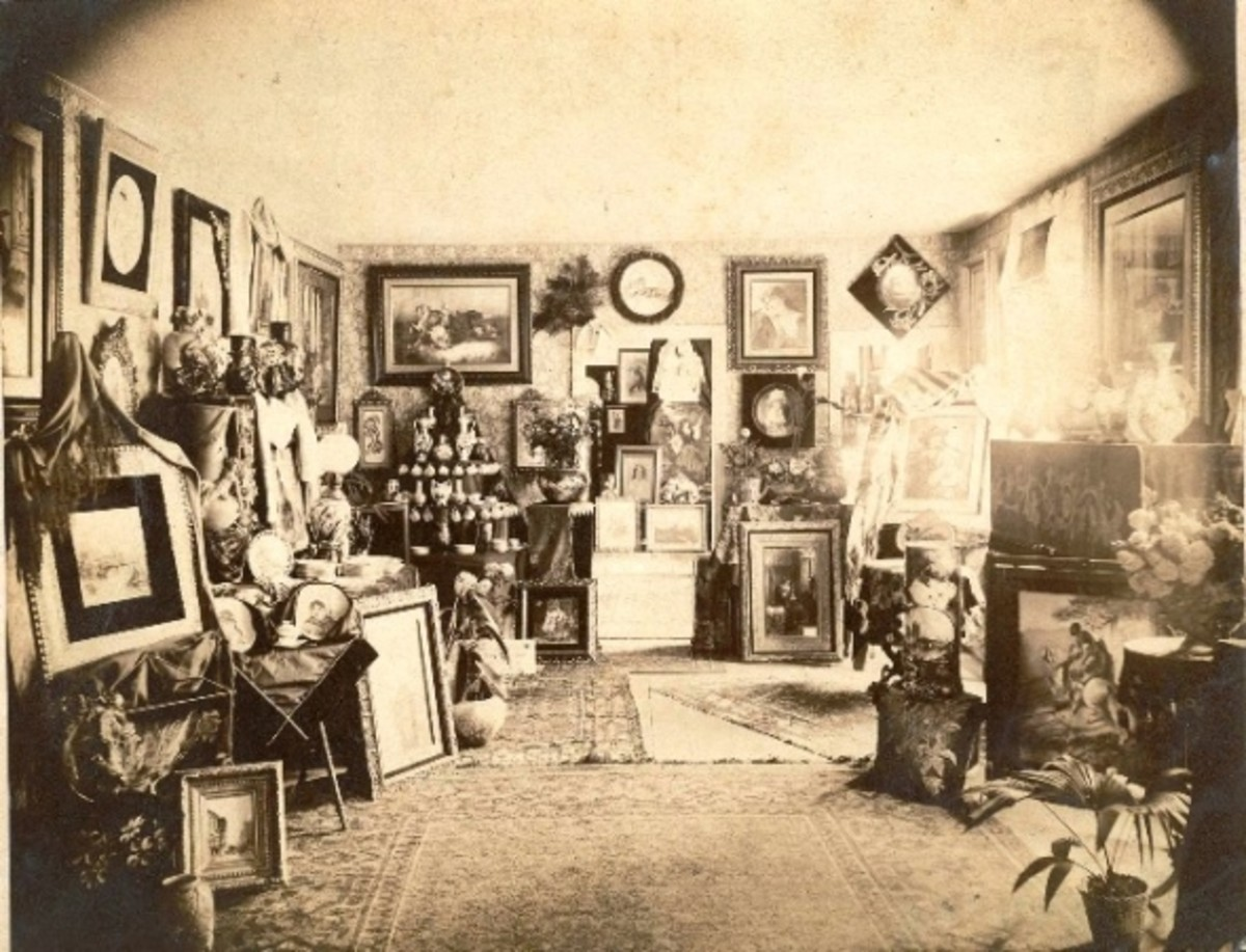 A period photo of a Victorian interior. Note the numerous framed pictures on the wall and the decorative objects on every available surface. Scroll down to see more room settings in our gallery of Victorian interiors.