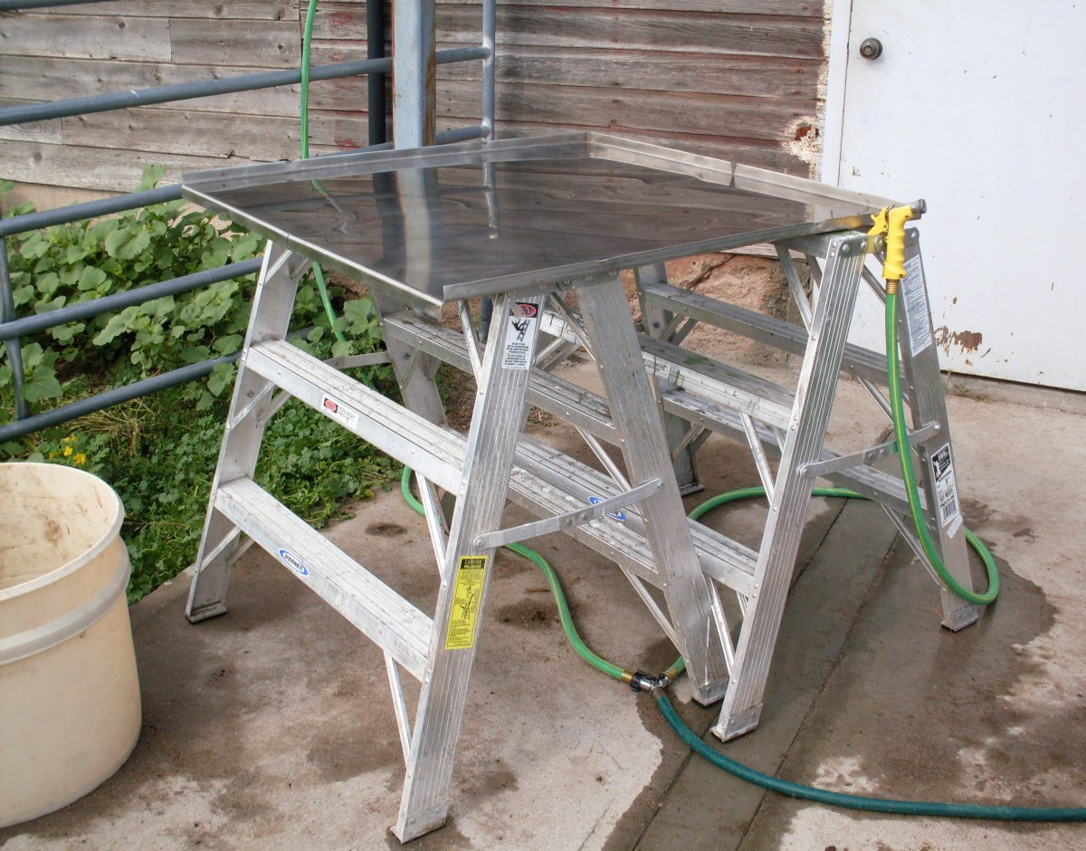 "Our work table, a stainless steel sheet with ""lips"" on 3 sides. We also had 2 garden hoses with spray nozzles."
