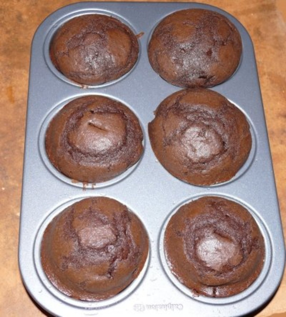 Chocolate cupcakes, all done and ready to cool and frost!