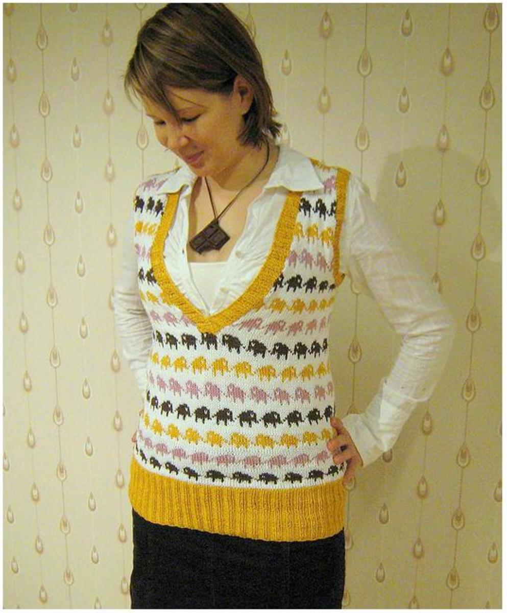 This sweater makes use of a technique known as steeking, where knitwear is knitted in the round without leaving gaps for sleeves etc. as you work. Then later the knitting is cut to create the openings.