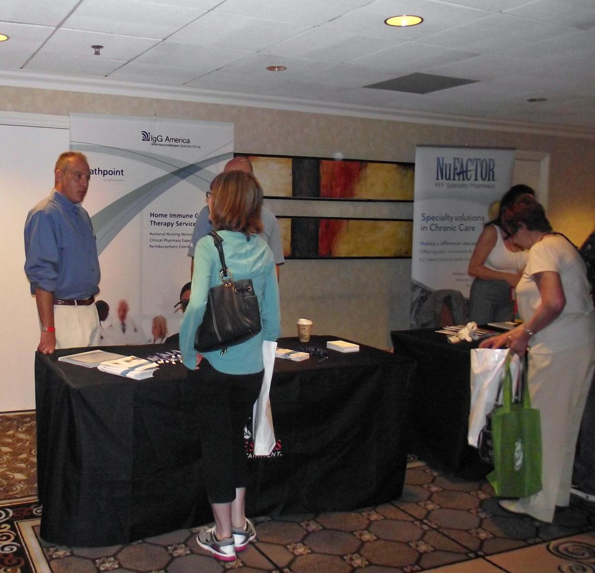 Patients receiving information at a conference display.