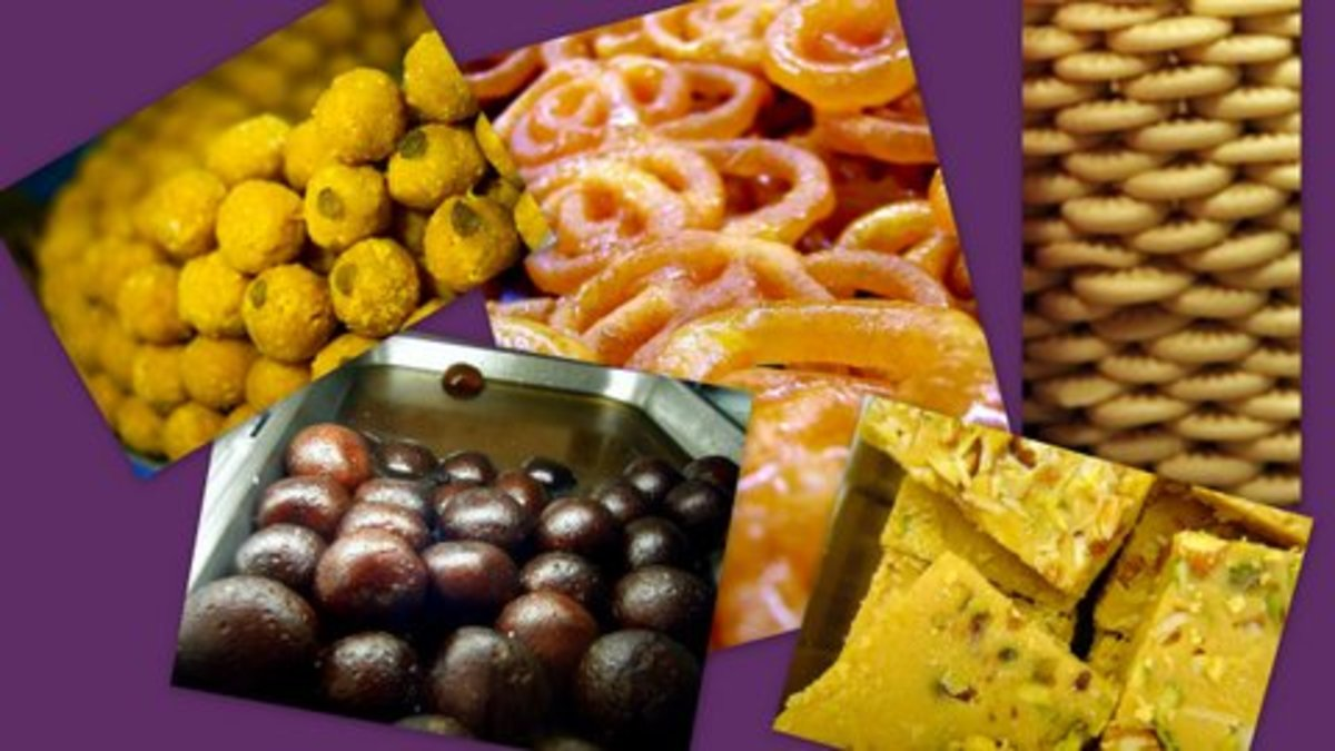 Some of the Indian Sweets, from top left clockwise. Laddu, Jelebi, Palkova, Halwa and Gulab Jamun