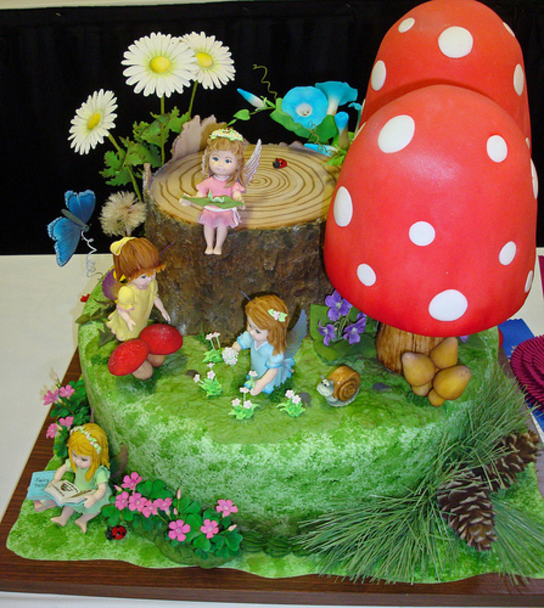 This is just a crazy cake.  I can't believe those fairies are edible!  They are so detailed and accurate.