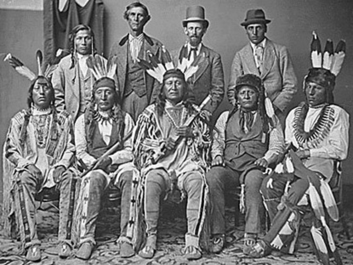 North Dakota Oil and Gas: The Three Affiliated Tribes. This is a Mandan and Arikara delegation. Six Indians with three escorts (back row), 1874.