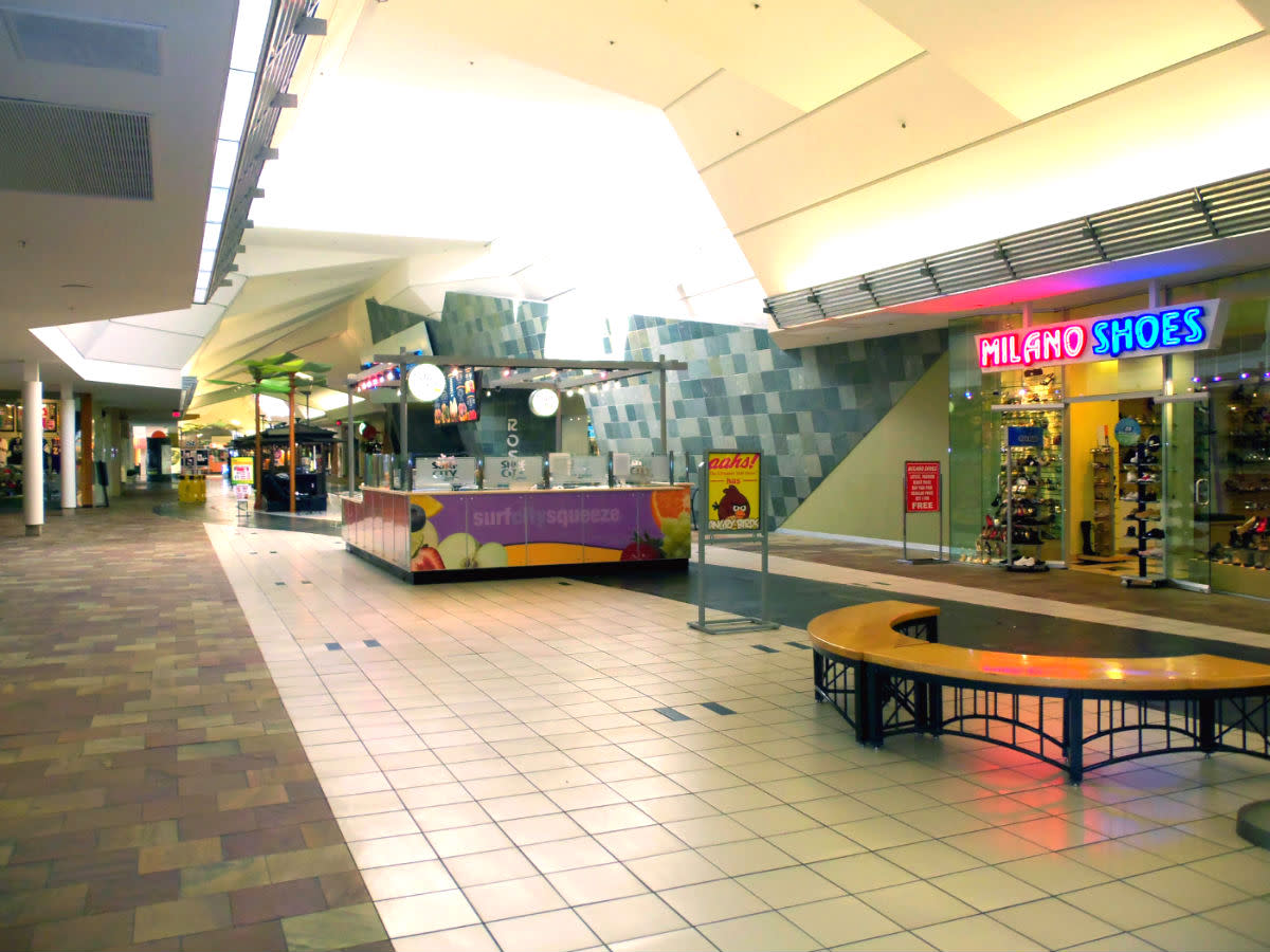 "- A small ""Slice"" of the Buena Park Mall of which encapsulates the overall "" Design & Feel"" of the venue - Floor tile blend, ceiling facets, and examples of the ""Mini Businesses"" operated by the many ""Isle Merchants"" found throughout the mall -"