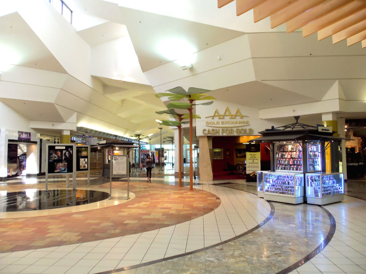 """- A perfect example of the strikingly beautiful contemporary gemstone  """"Ceiling Facet"""" design found throughout the mall - Earth tone """"Colors & Hues"""" are predominant from top to bottom as a soft, posh welcome to shoppers arriving from near and far -"""